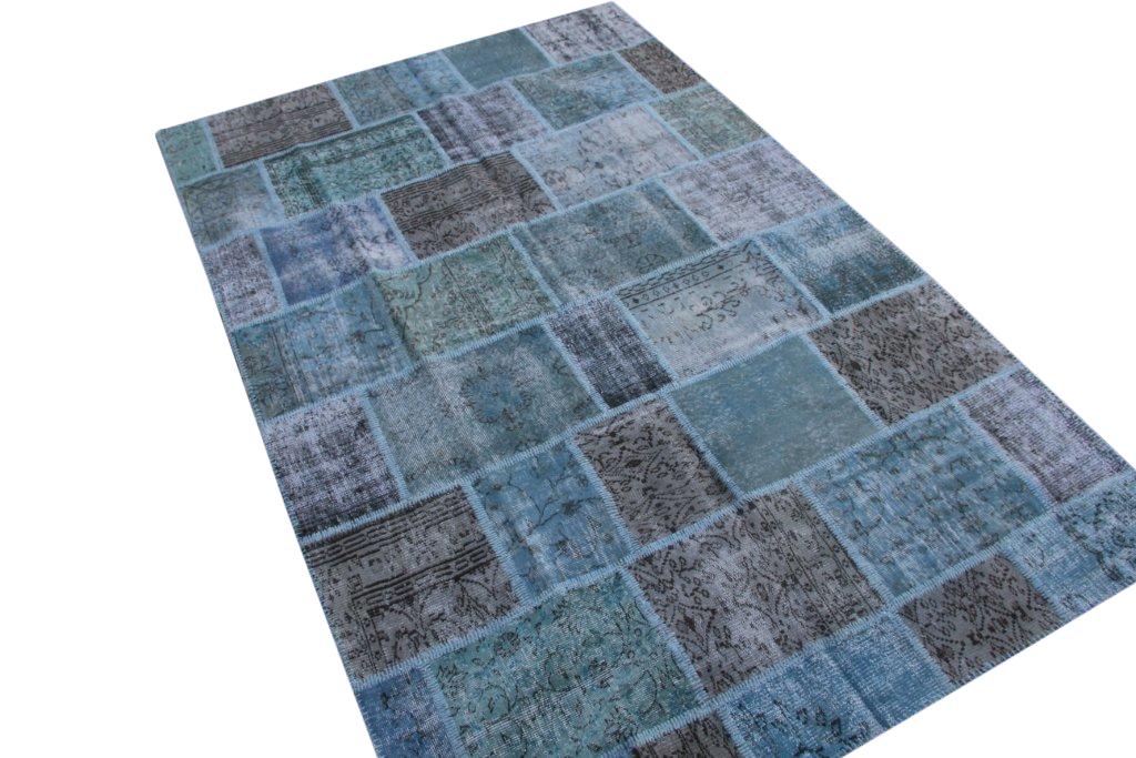Vintage patchwork vloerkleed 5297 (303cm x 196cm) gemaakt van oude recoloured vloerkleden