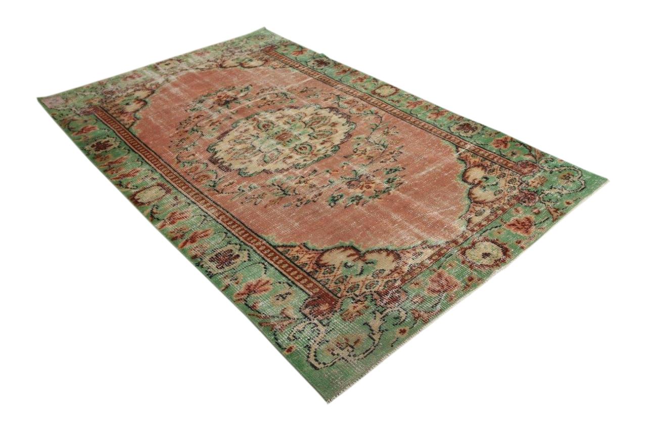 Vintage vloerkleed met aardetinten en groen