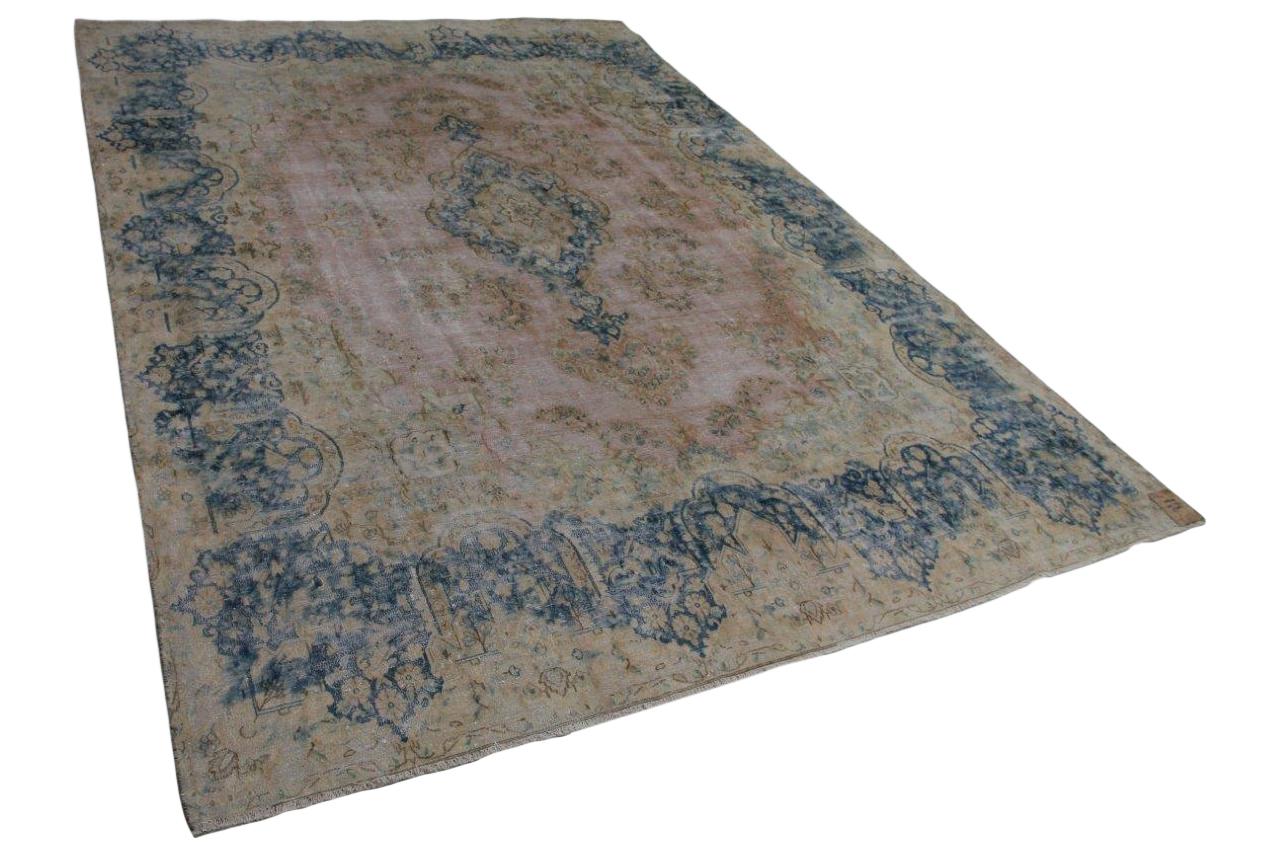 vintage vloerkleed met blauw, baksteenrood en zandkleur